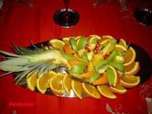 Macedonia di Ananas con kiwi, melograno e arance.